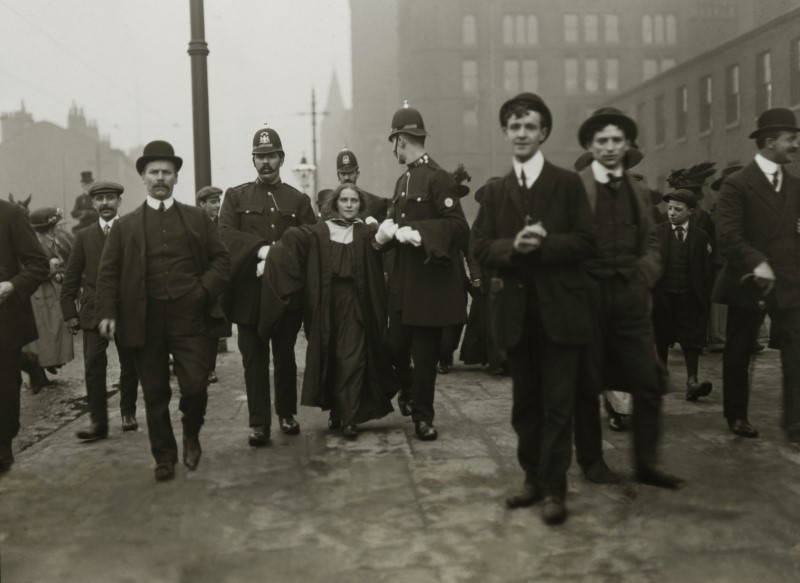 Dora Marsden being arrested for her suffragette activism in Manchester 1909. Image from Greater Manchester Police Museum